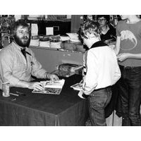 [Chris Claremont signing The Uncanny X-Men (Product Image)]