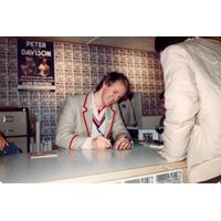[Peter Davison signing Peter Davison's Book of the Alien Monsters (Product Image)]