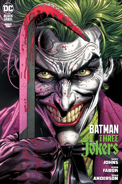 Images shows the cover of Batman: Three Jokers #1. The Joker's face is the main focus, as he holds a bloodied crowbar in his right hand. There is blood spatter over his purple gove, white makeup, and purple coat.