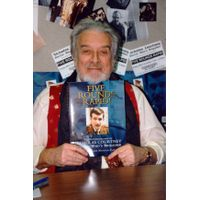 [Nicholas Courtney signing Five Rounds Rapid! (Product Image)]