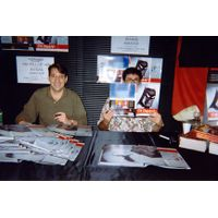 [Paul Dini and Chip Kidd signing Batman Animated (Product Image)]
