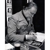 [John Brunner signing Crucible of Time (Product Image)]